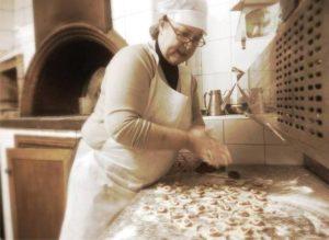 Chef Rita making fresh pasta in Italian kitchen