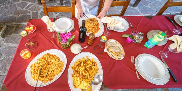 Dinner table from above with fresh Italian pasta dishes ready to dine