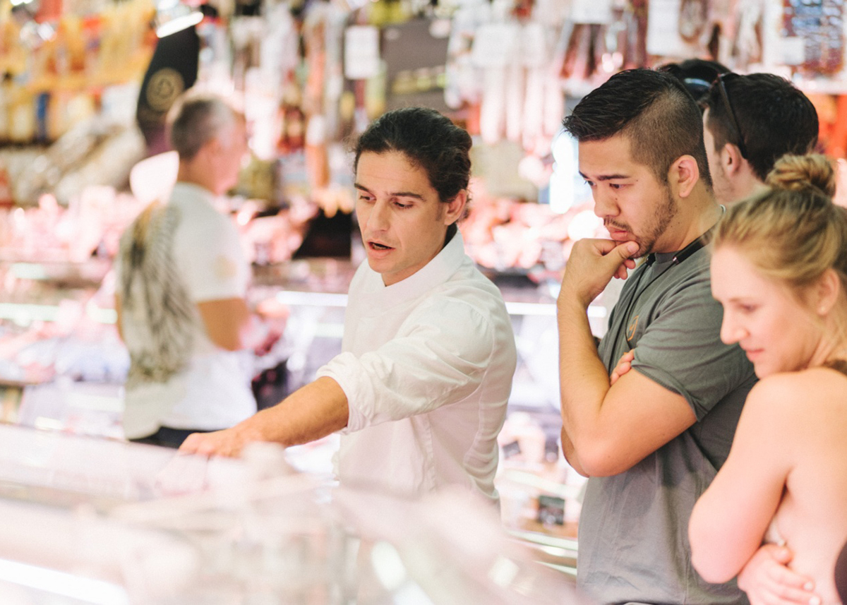 local chef taking a person on a market tour