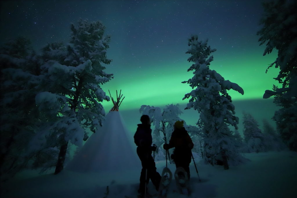 couple snowshoeing in finland