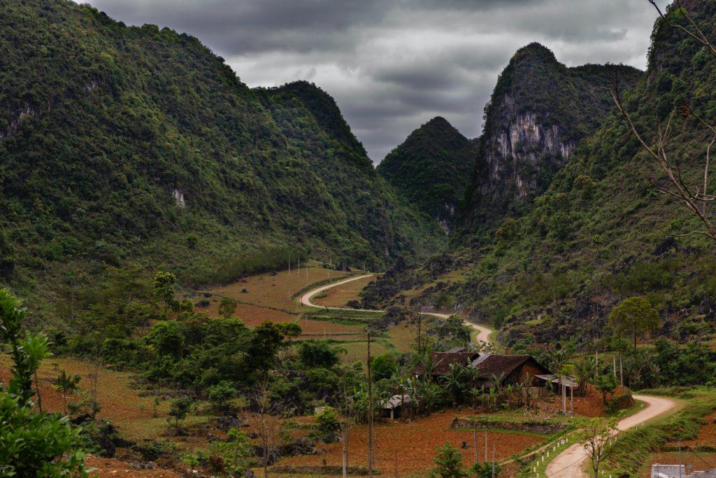 house underneath mountains in vietnam