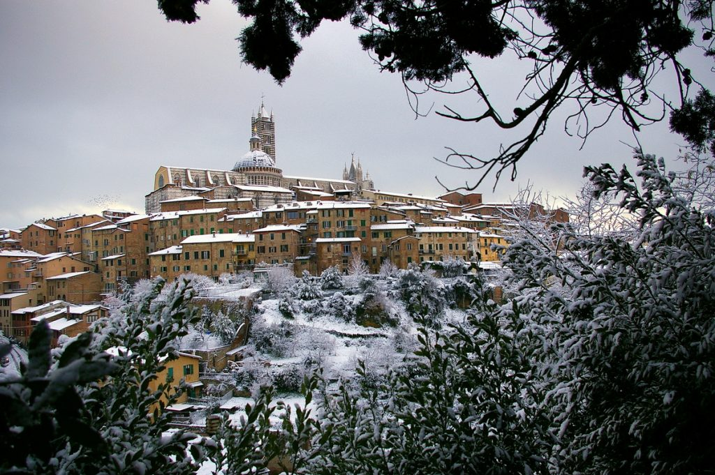 a hilltop town in tuscany in the winter