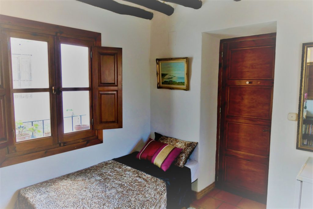 single bedroom in Spanish home on bread baking holiday