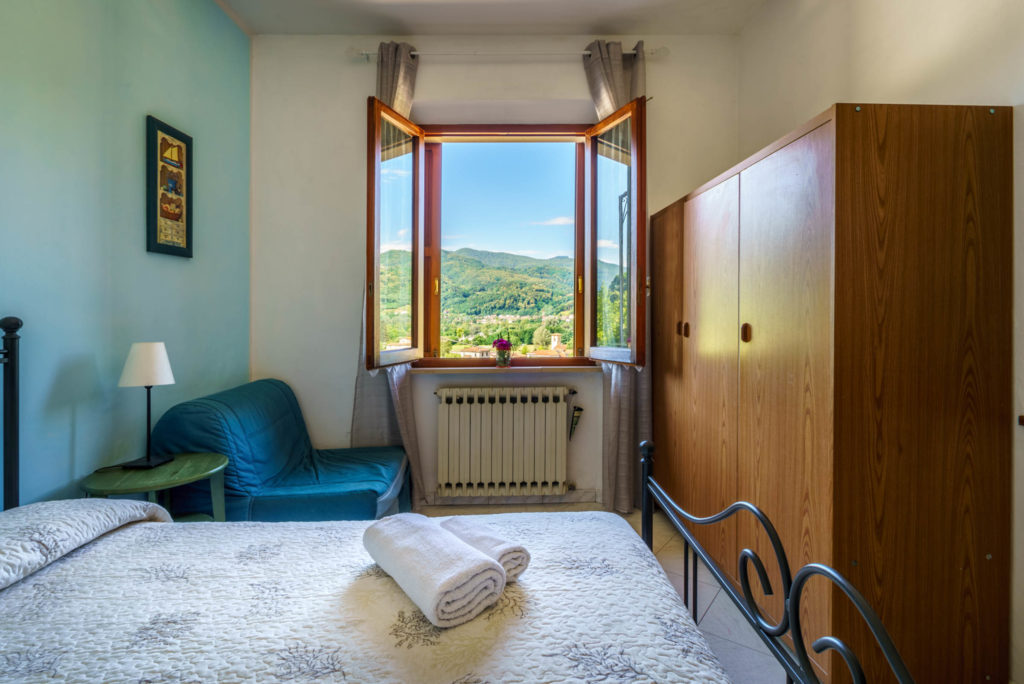 double bedroom accommodation on with hill view Italian cookery holiday