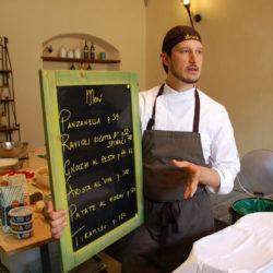 Italian chef explains menu on chalkboard