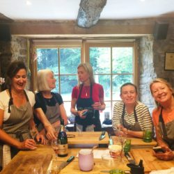 French cookery guests drink champagne and prepare food