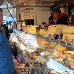 shopping for cheese at the market