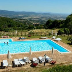 swimming pool and loungers overlooking hills