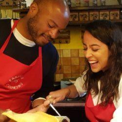cooking guests having fun making fresh pasta