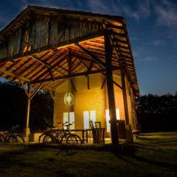 old renovated barn lit up at night