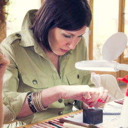 guests making jewellery in the studio