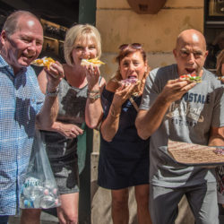 Cooking guests on walking food tour of Rome