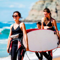 Surfers carrying their boards