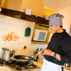 Chef Fabrizio cooking in his Tuscan kitchen