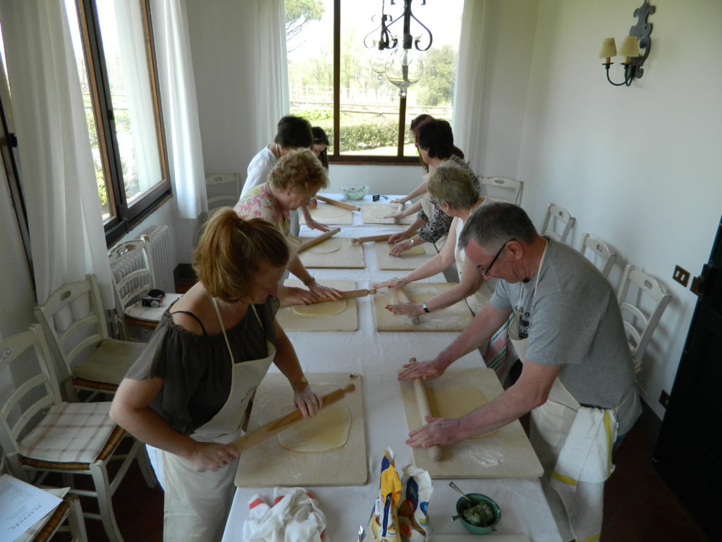 rolling out pasta dough in the cookery lesson