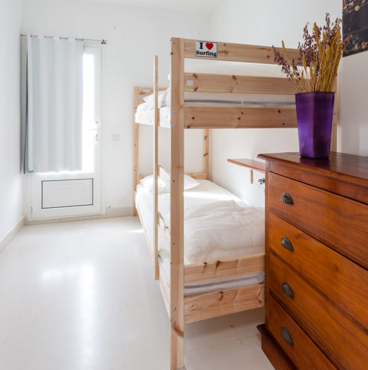 bunk beds in white airy room