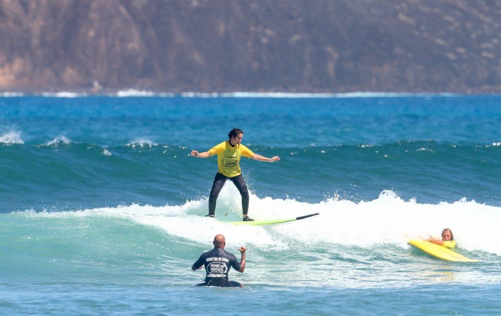 surfer rides the waves in Fuerteventura
