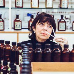 Woman sampling perfume scents