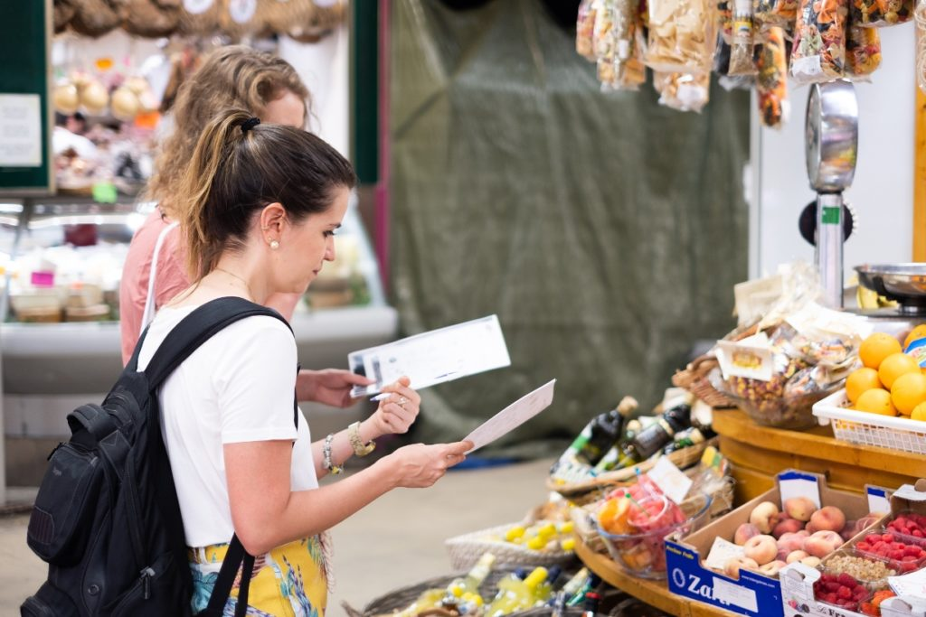 italian language students learning at the market
