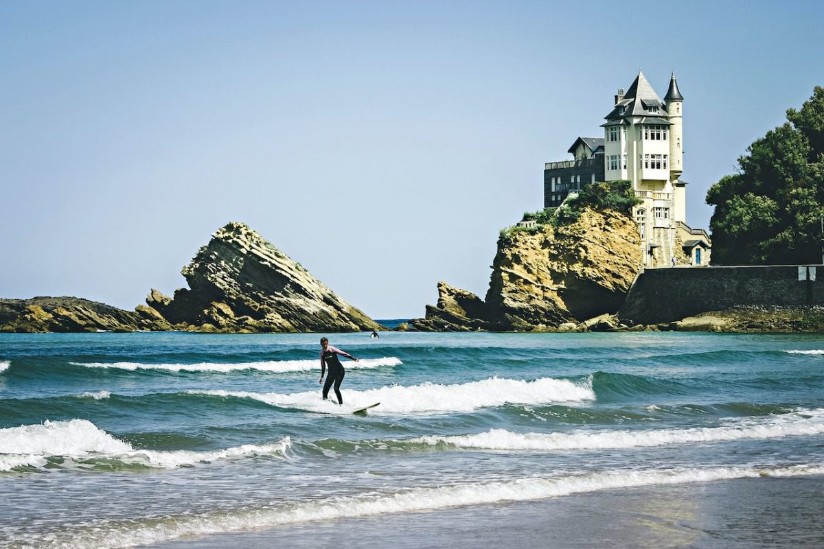surfer riding waves in Biarritz