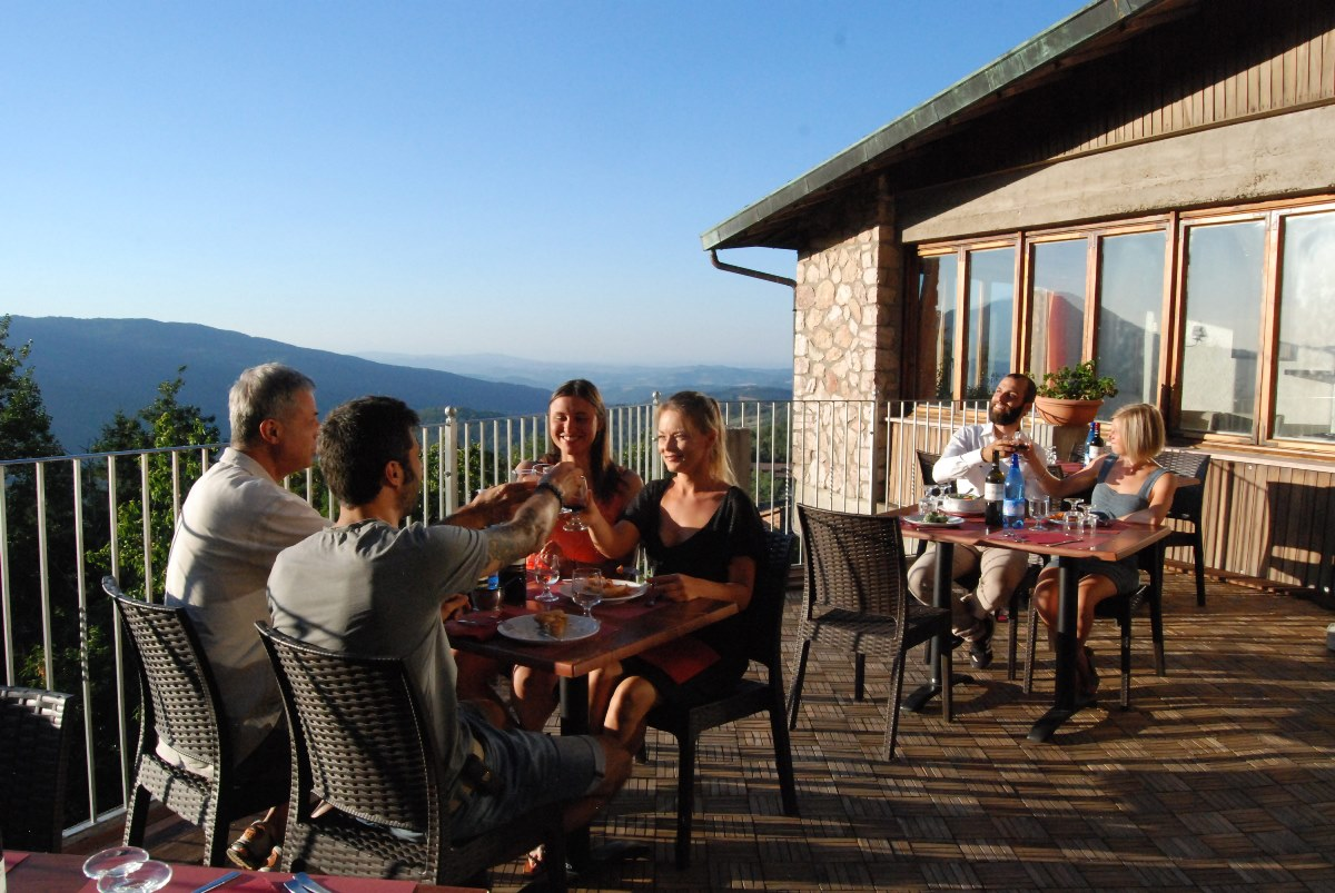 families dine outside on terrace