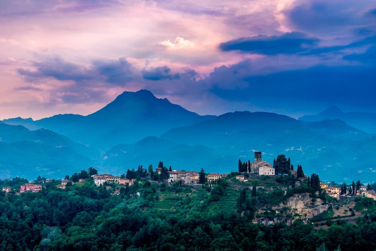 purple sky over hilltop village