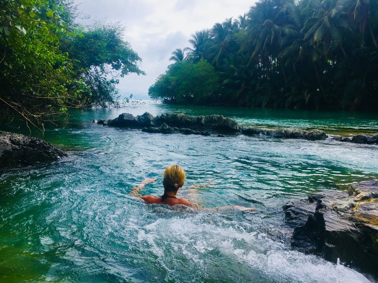 person relaxing in a natural pool in costa rica