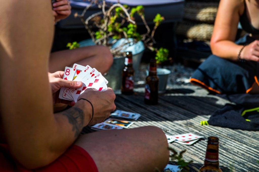 surfers playing cards
