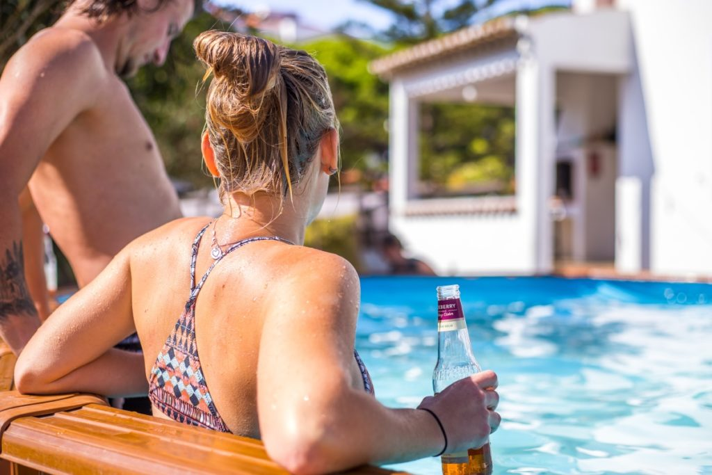 guest with beer in pool