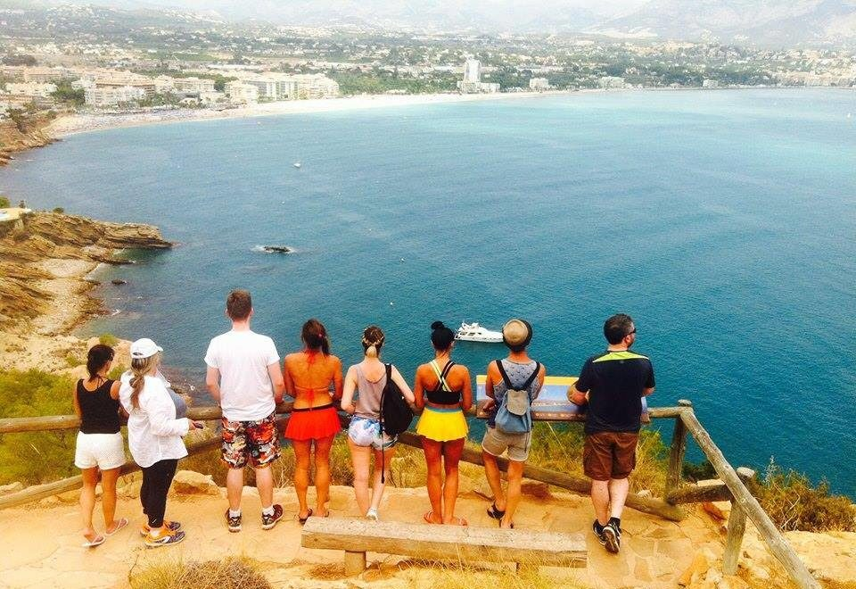 people looking at a view of the sea