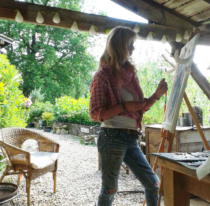Jo painting in her farmhouse