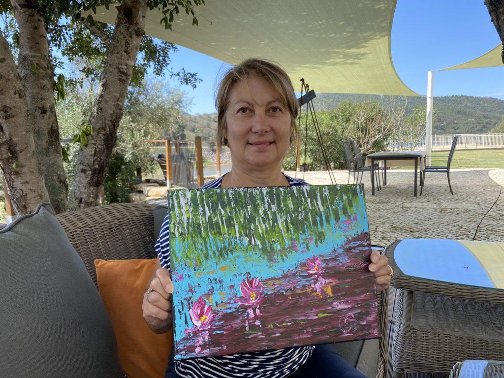 Cheryl holding a piece of her art work