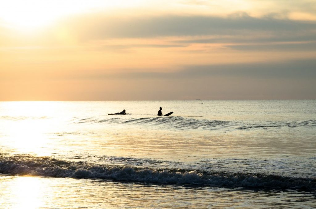 surfing at sunset in cornwall