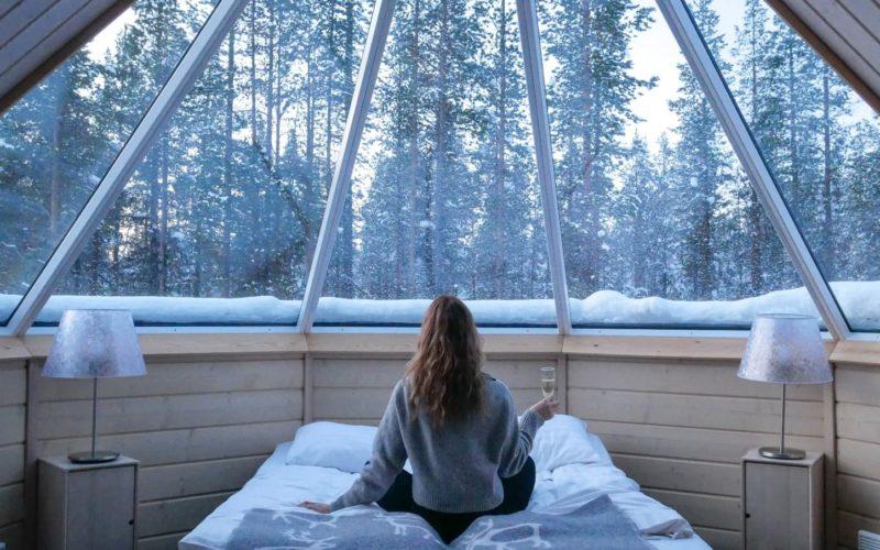 woman drinking champagne in Finnish snow hut
