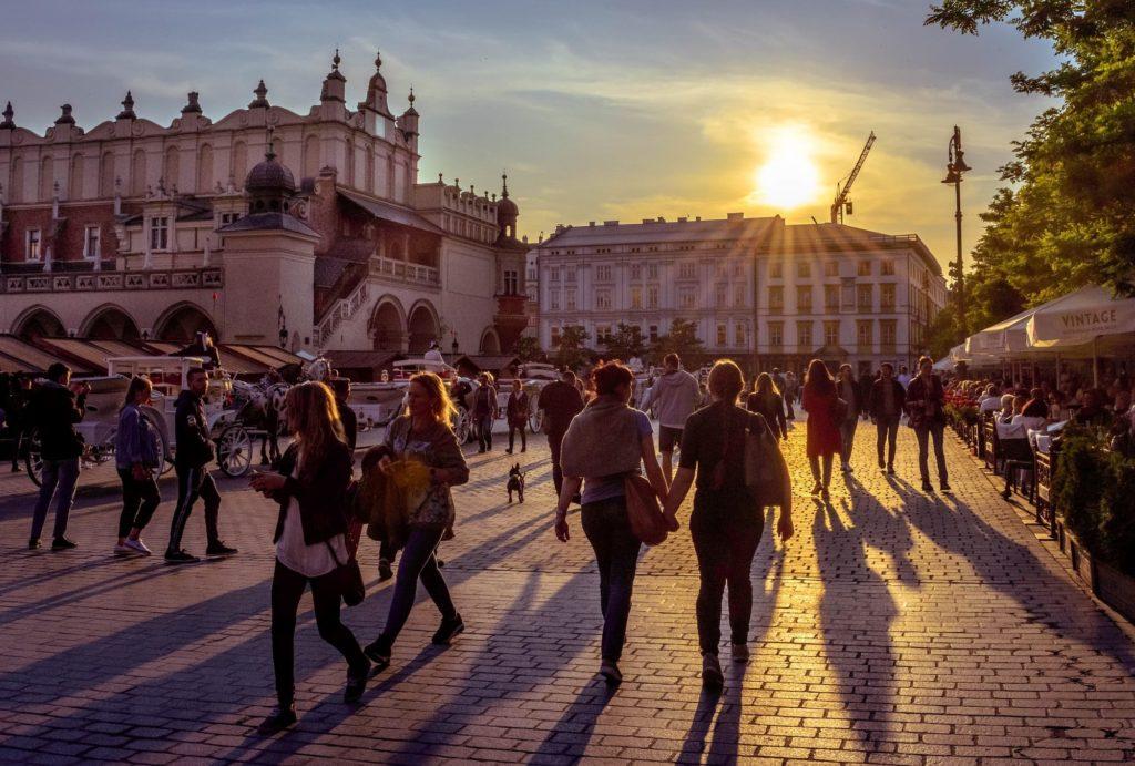walking in Krakow square at sunset
