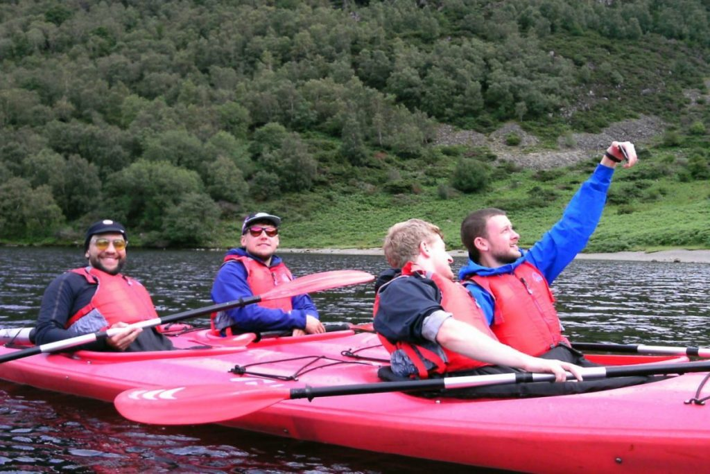 people kayaking in the lake district