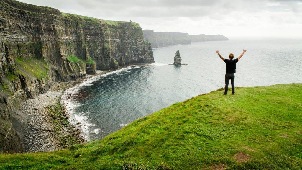 man hiking along coast in west Ireland
