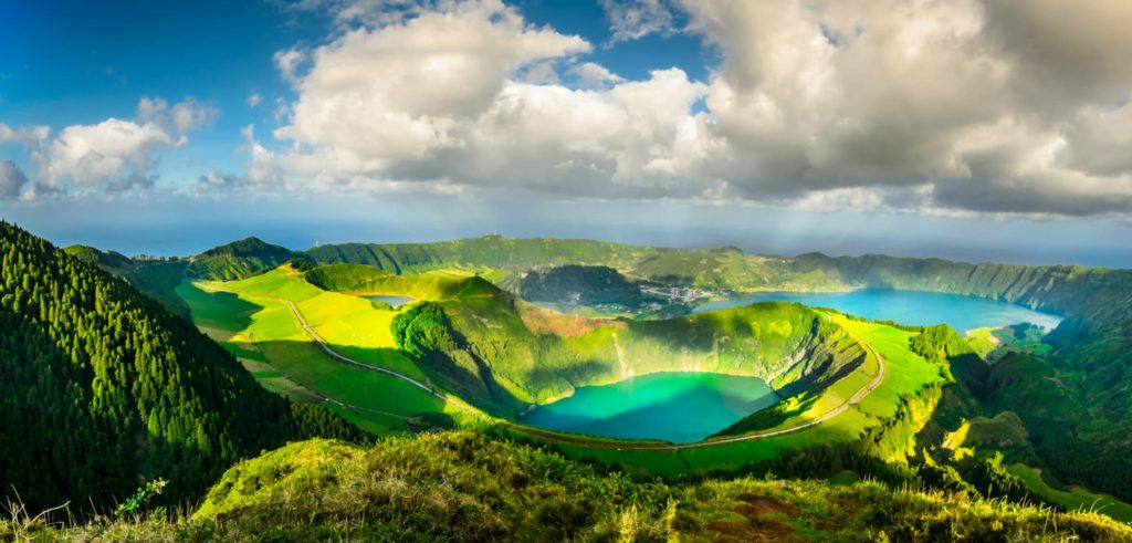 blue lake surrounded by green mountains