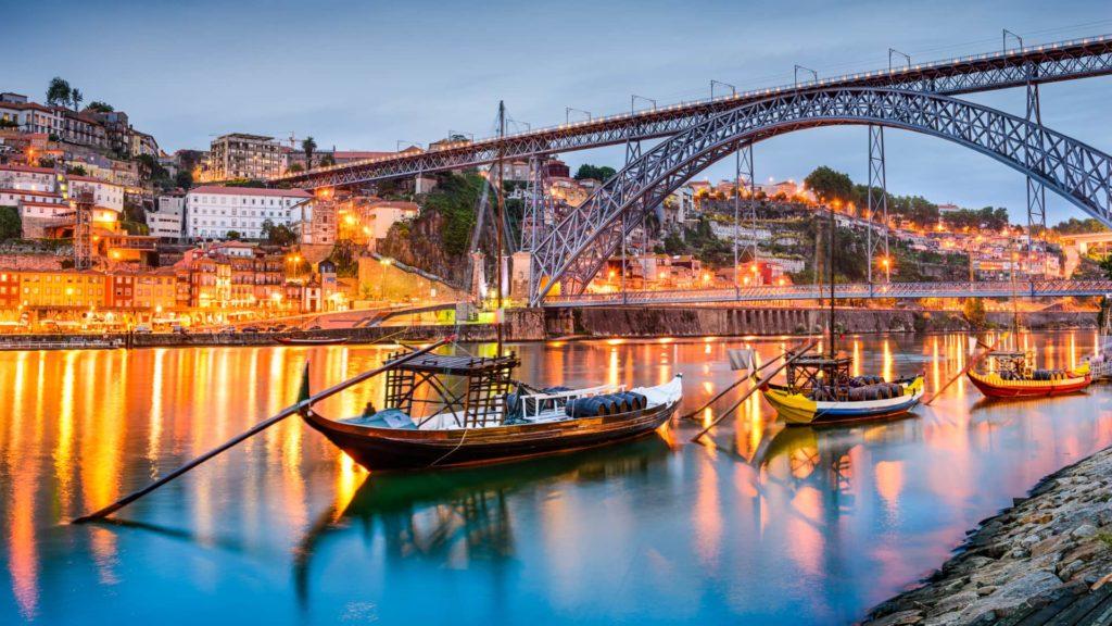 boat on river in porto at night