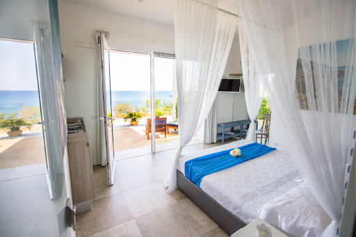 bed with sea view in sicily