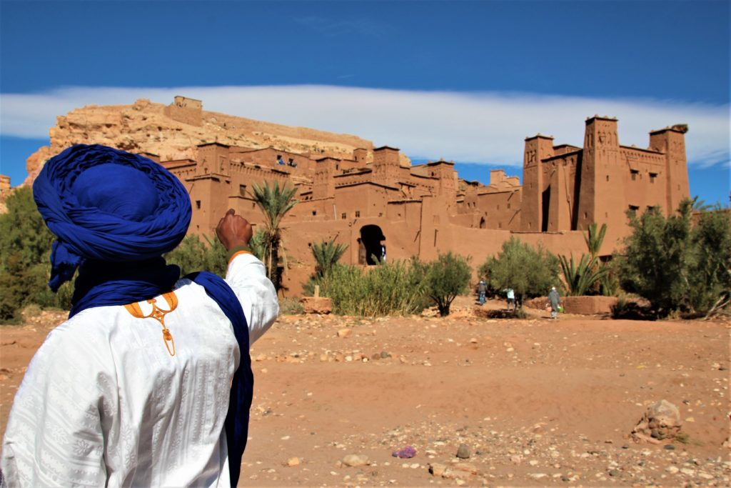 man pointing at ancient fortress morocco