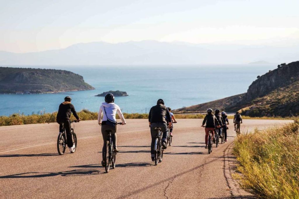 Group cycling on the coast of Napflio