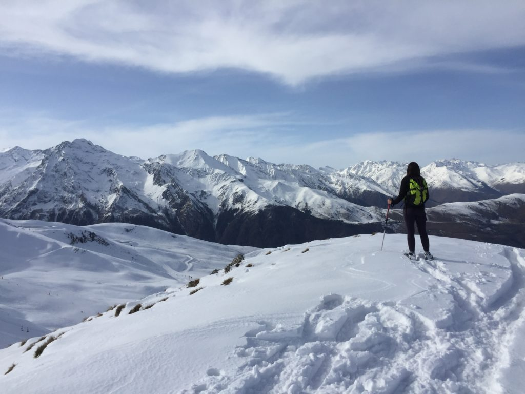 person standing on a mountain in the french pyrenees