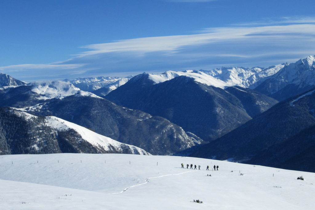 people snowshoeing in the french pyrenees