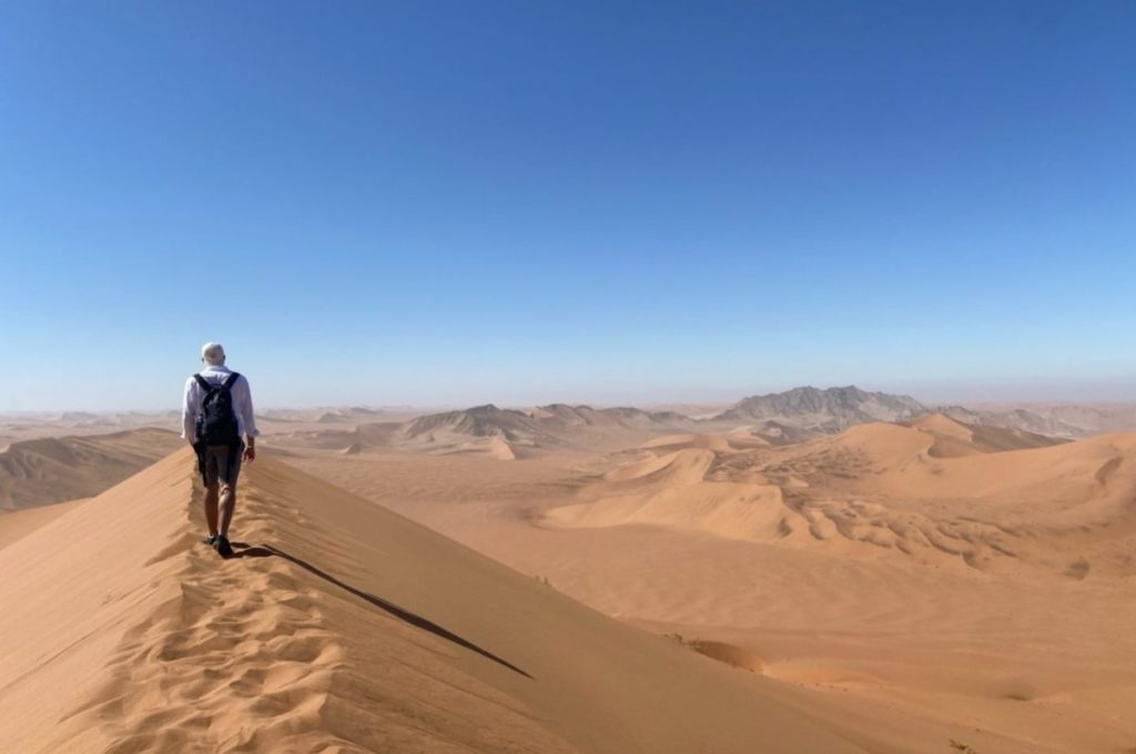 walking on a sand dune in namibia