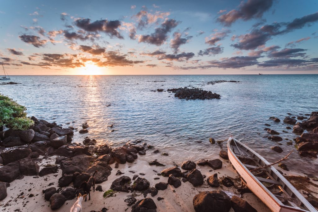 boat and sunset in mauritius