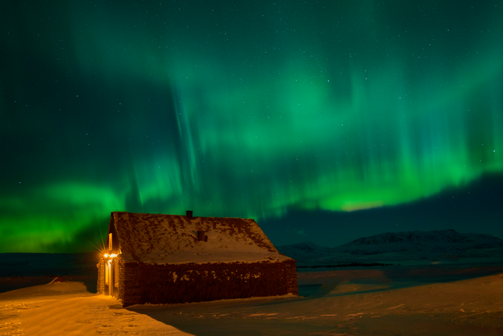 eco lodge retreat in iceland under the northern lights