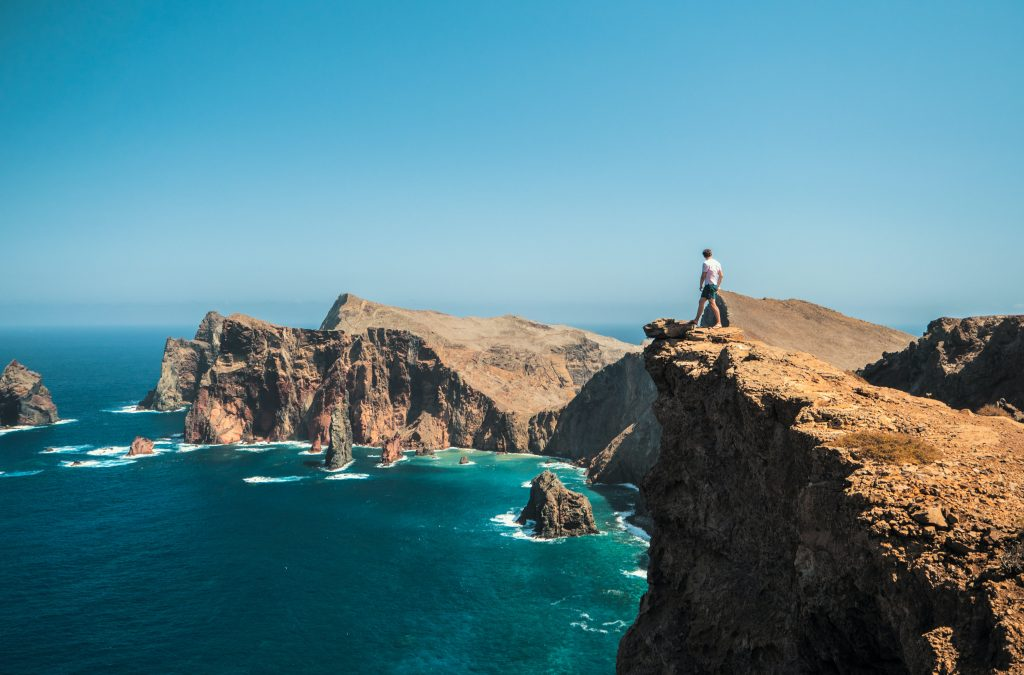 person standing on sea cliffs in madeira