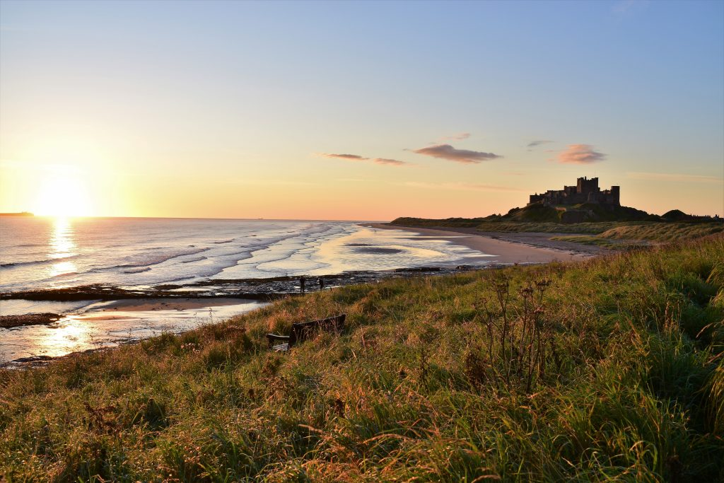 beach and castle in uk surf destination northumberland