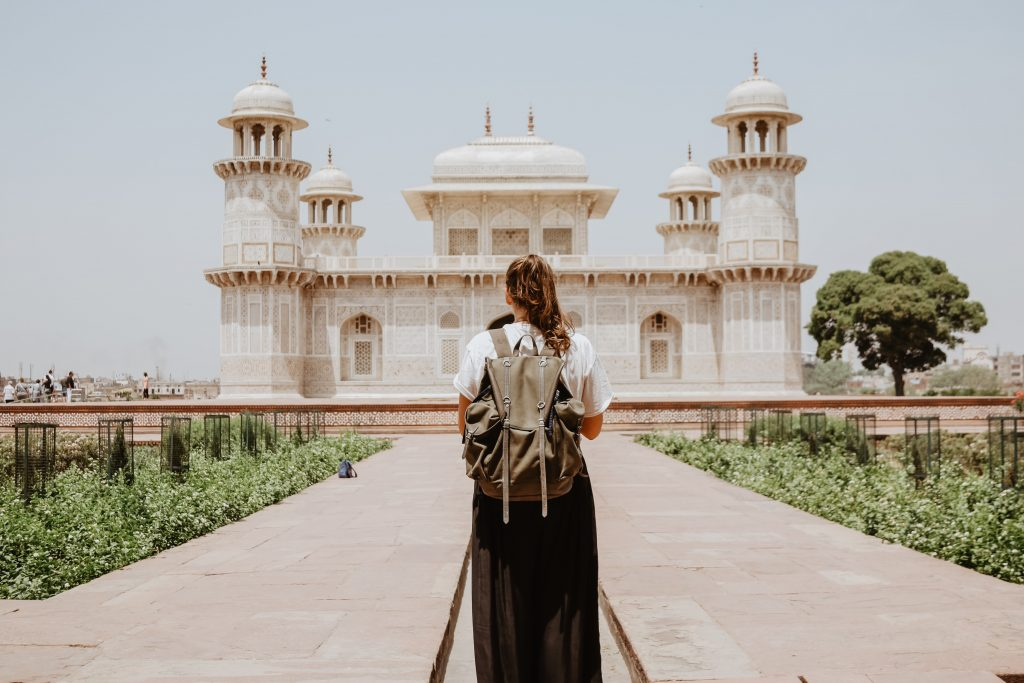 solo traveller in front of a temple